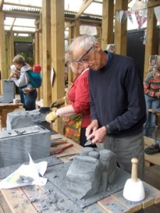 Carving garden gargoyles with the Kindest Group